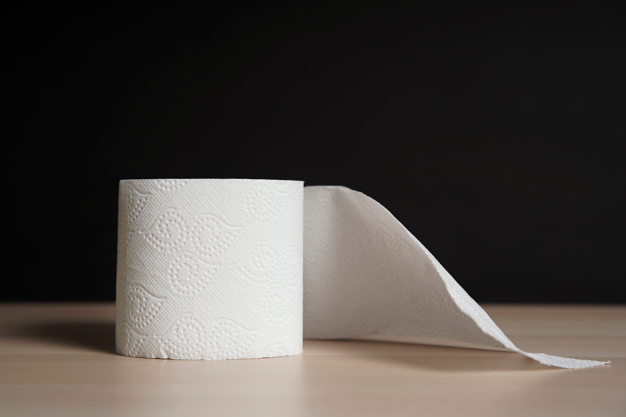 roll of toilet paper on black background