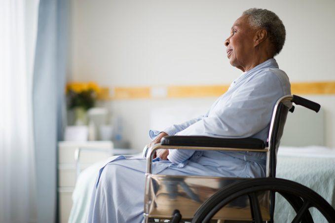 Black woman sitting in wheelchair in hospital