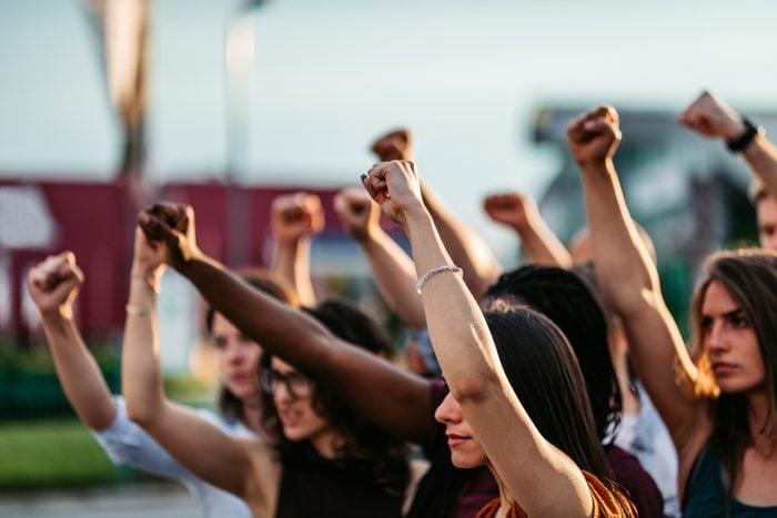 protestors raising fists for racial equality