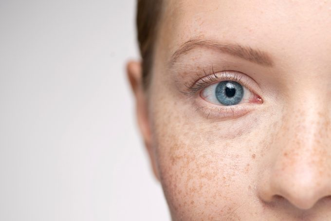 close up of half of young woman's face