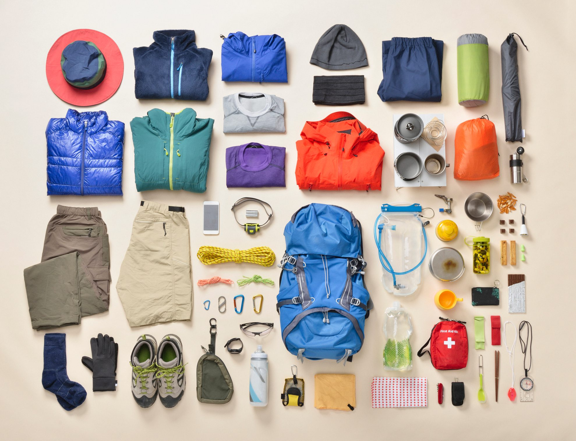 hiking gear essentials lay flat overhead