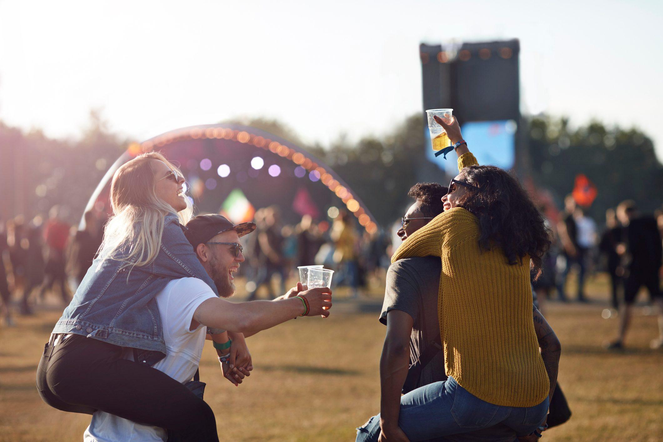 friends at music festival convert