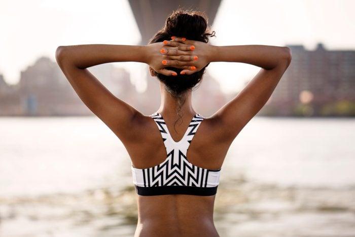 rear view of female jogger wearing a sports bra