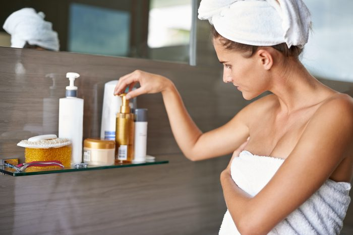 woman in towel after shower in bathroom