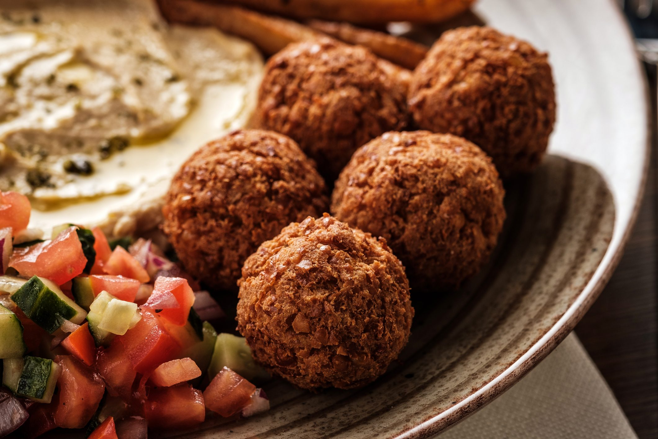 Close-up of Traditional falafel balls with salad and hummus on a plate