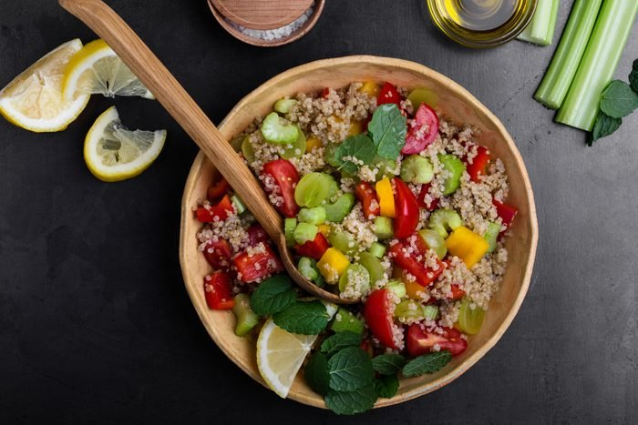 Quinoa salad with red and yellow bell peppers tomatoes, celery and grapes