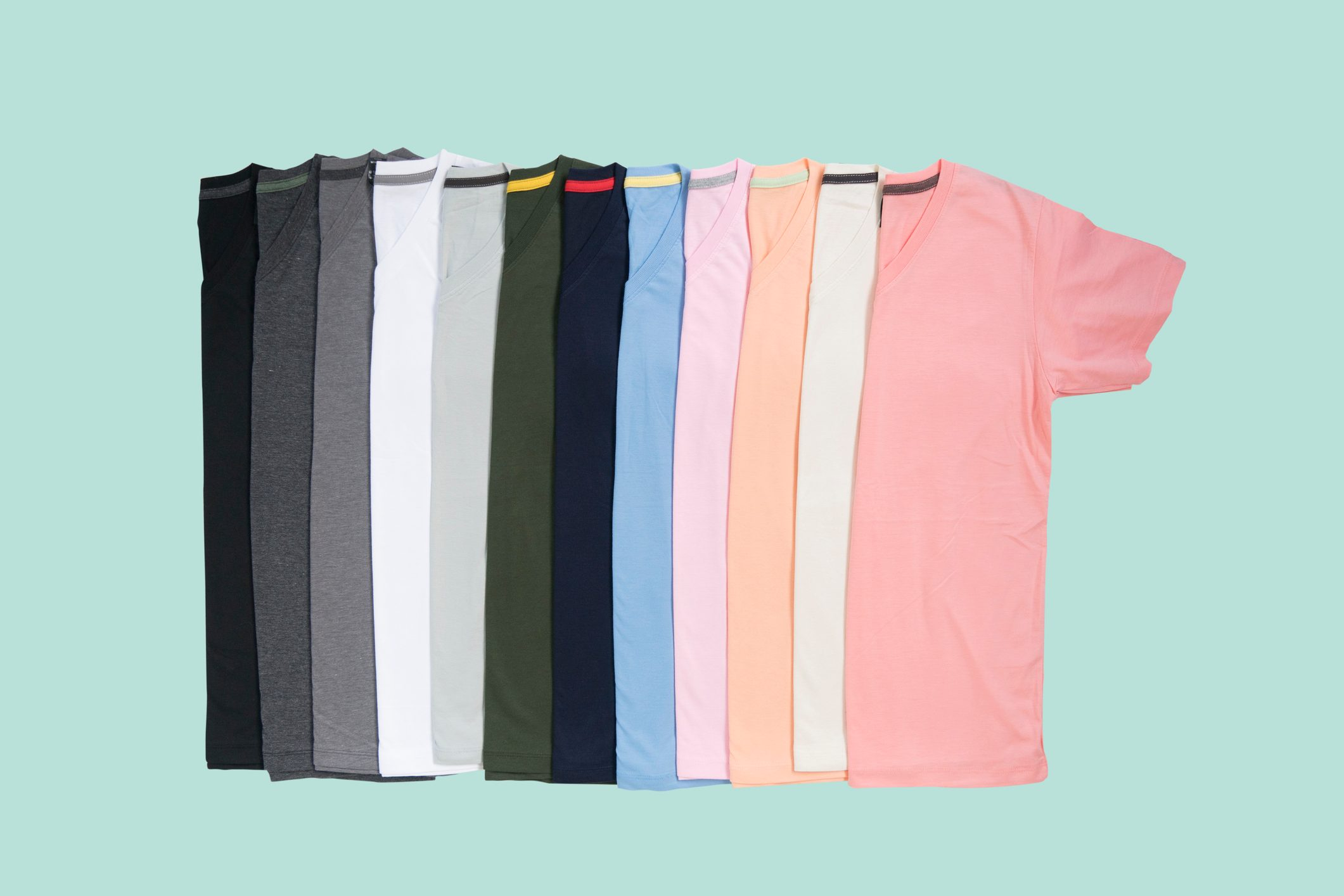 colorful t shirts on teal colored background