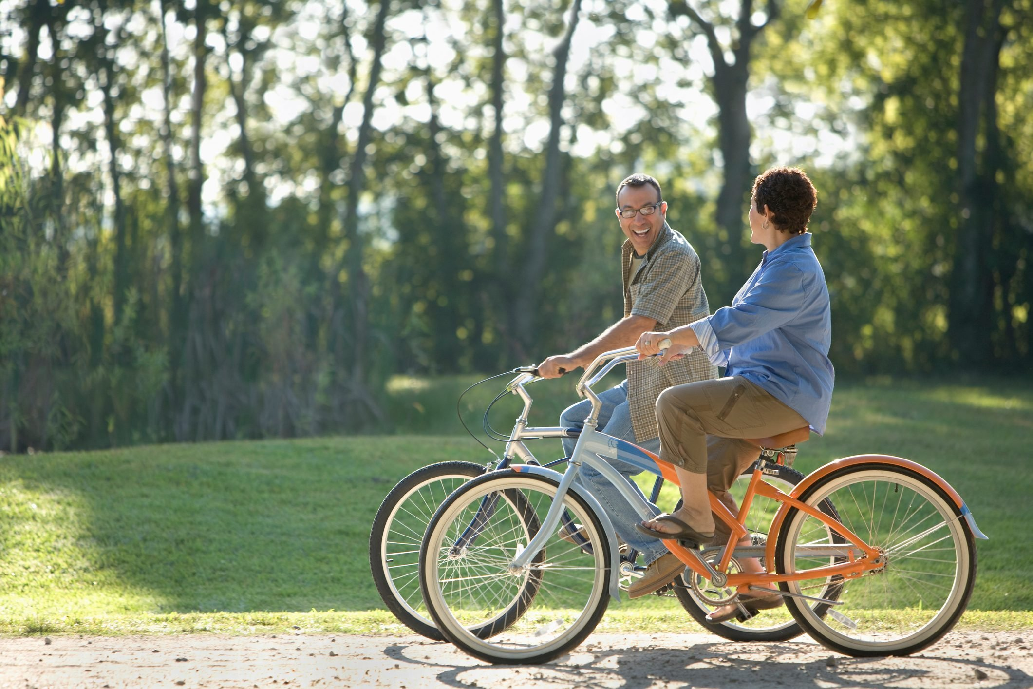 couple riding bikes together on a sunny day