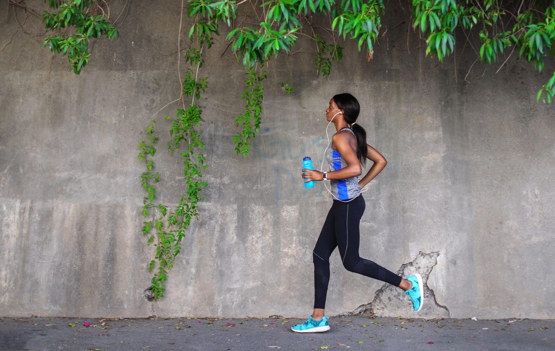 young female runner running outside