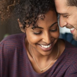 young romantic couple smiling together