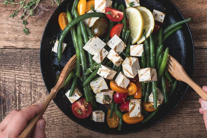 Vegan meal, cooking green beans salad with grilled tofu