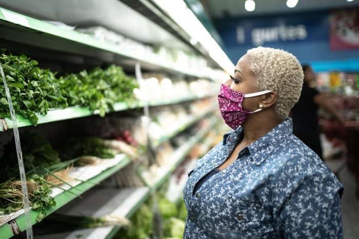 woman wearing face mask in grocery store