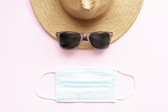 sunglasses, beach hat, and face mask