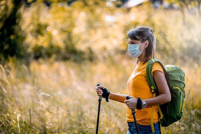 woman taking a hike with face mask on