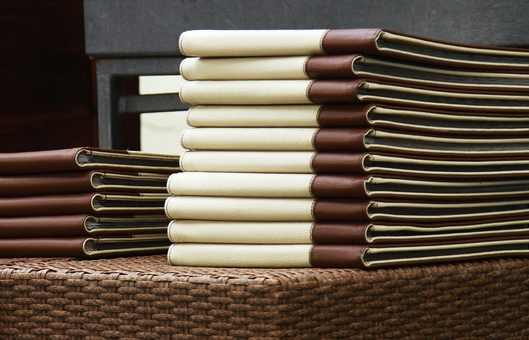 stack of menus in a restaurant