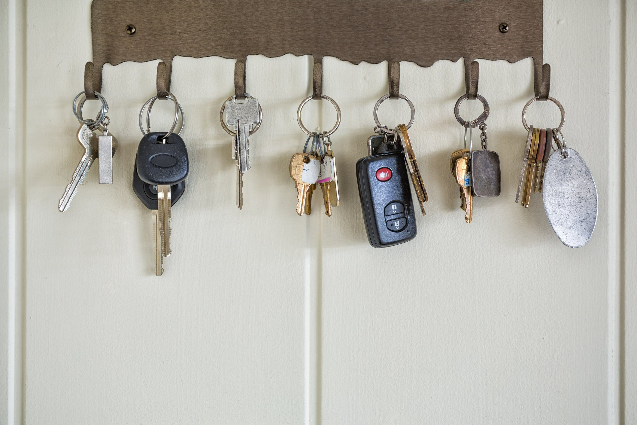 Several types of keys hanging on wall hooks