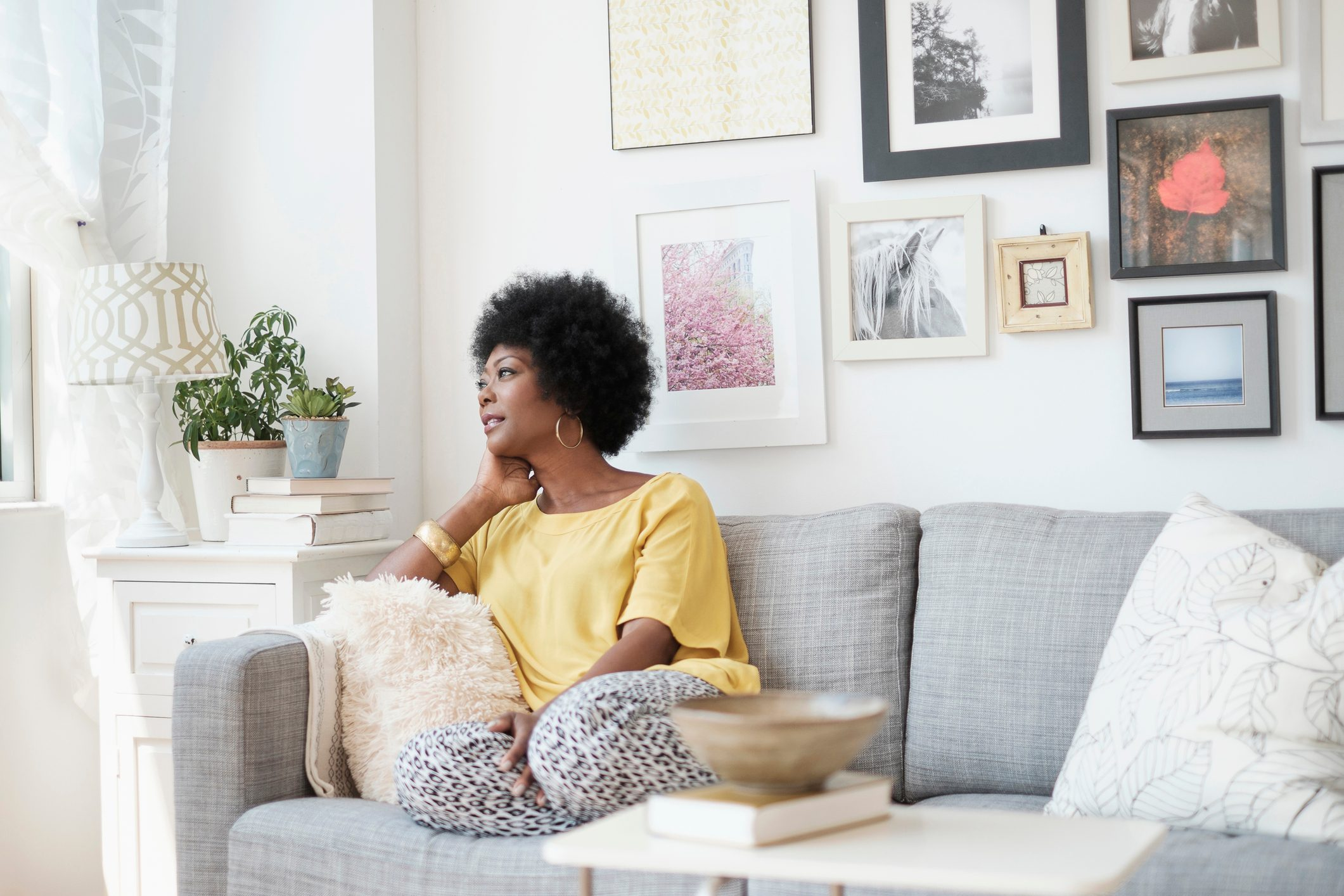woman sitting at home and relaxing on couch