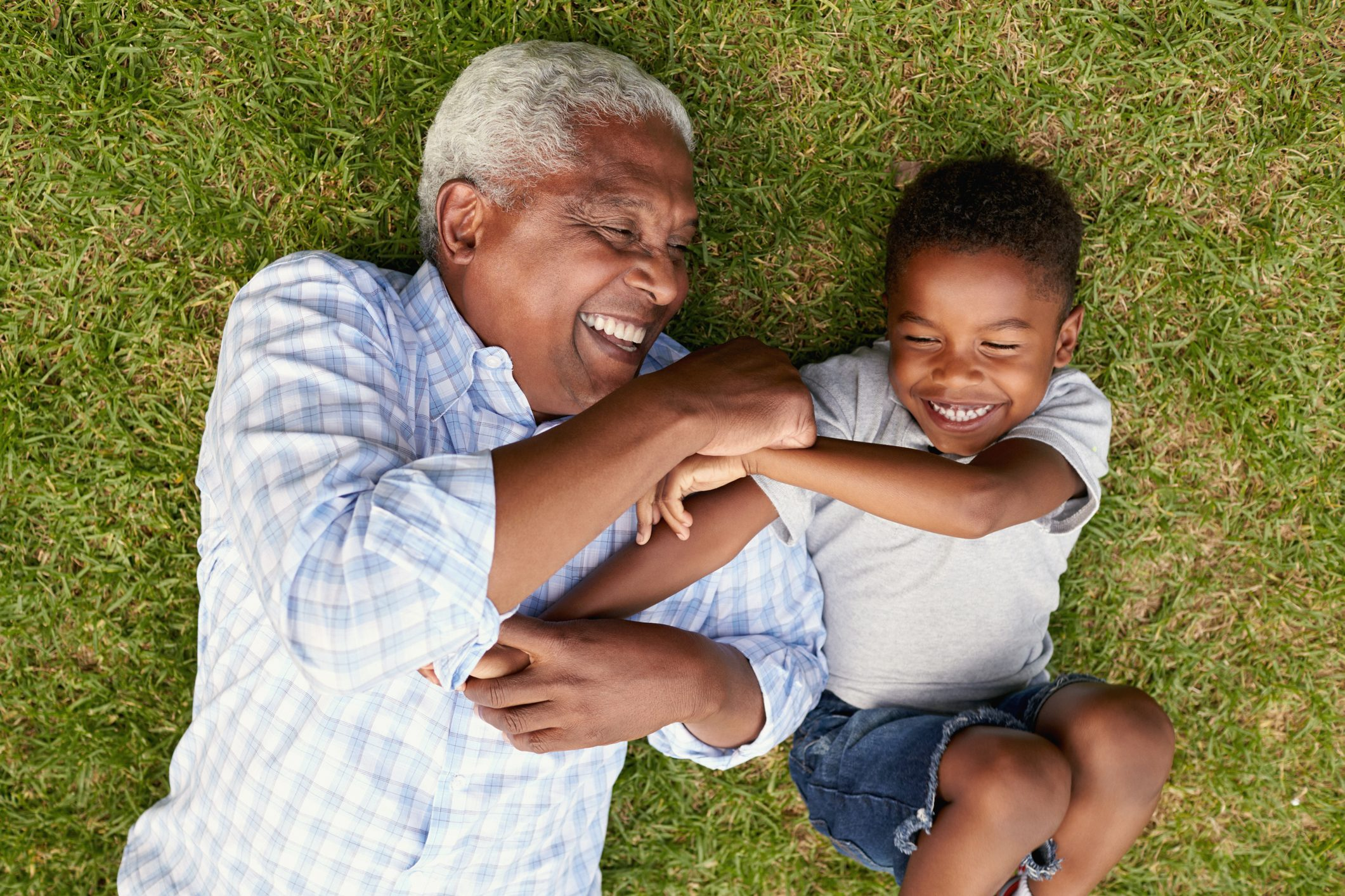 grandfather and grandson laughing together overhead