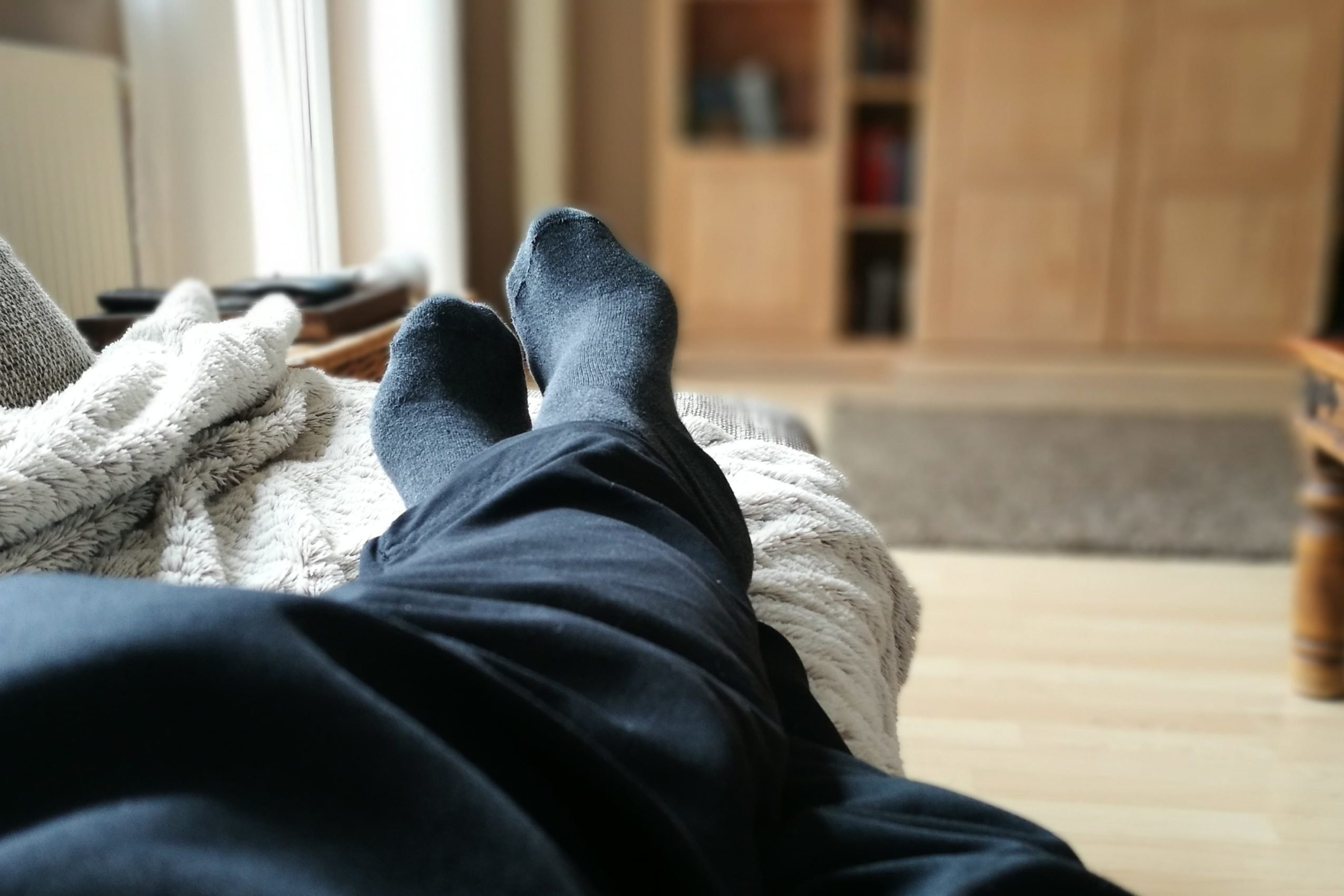 person resting on couch at home