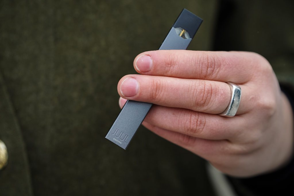Woman holding Juul e-cig