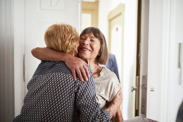 Senior couple visiting friends in their home