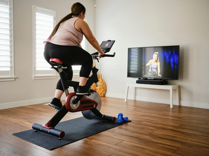 Woman Using Exercise Bike in a Home