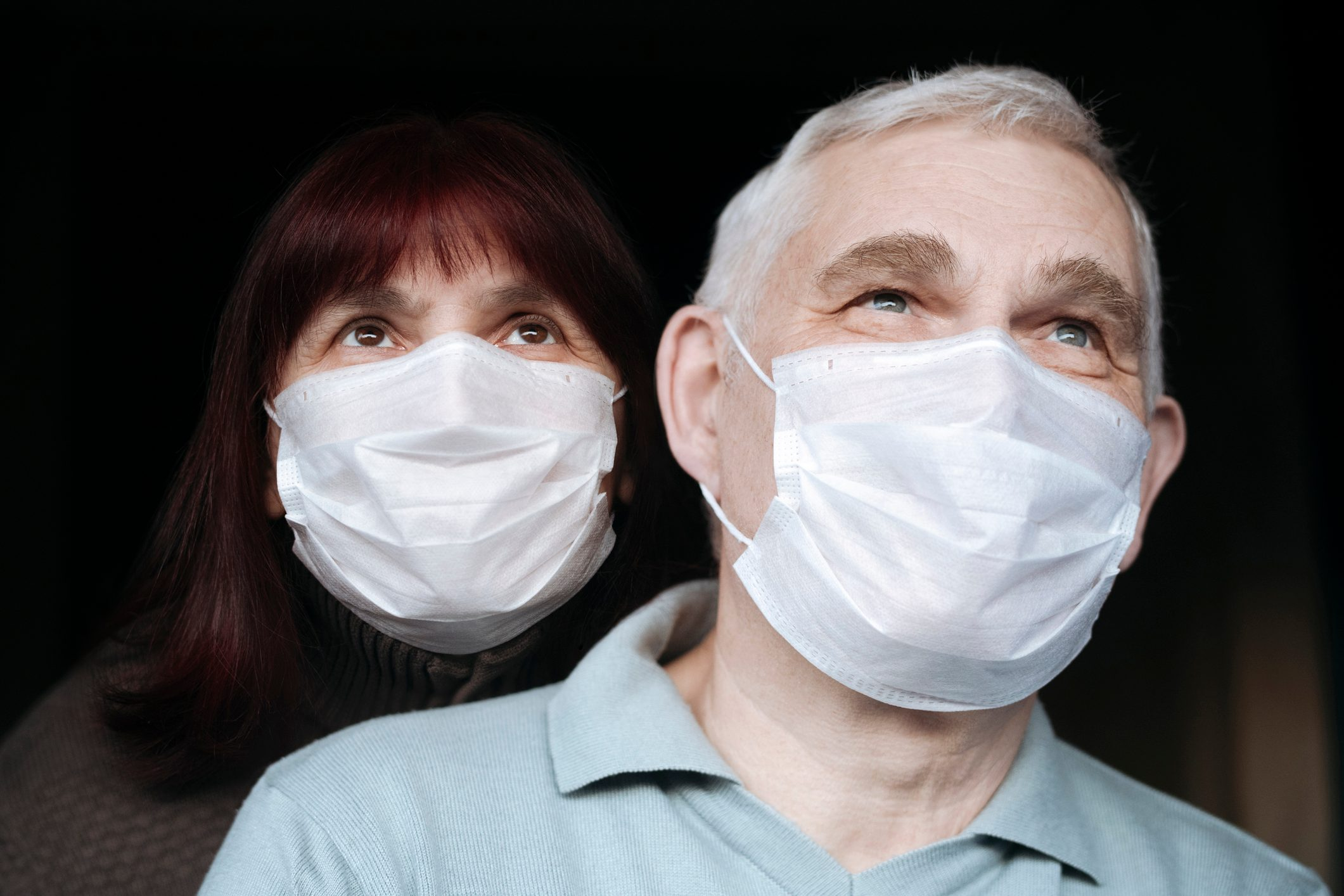 Portrait of senior couple wearing masks at home