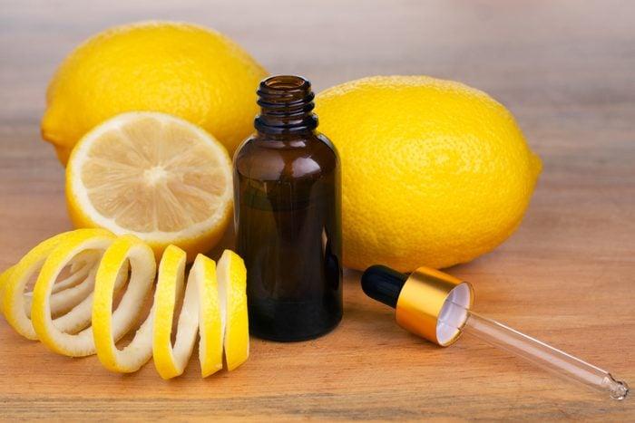 Lemon Essential Oil In A Bottle Withlemon Essential Oil In A Bottle With Lemon On The Side