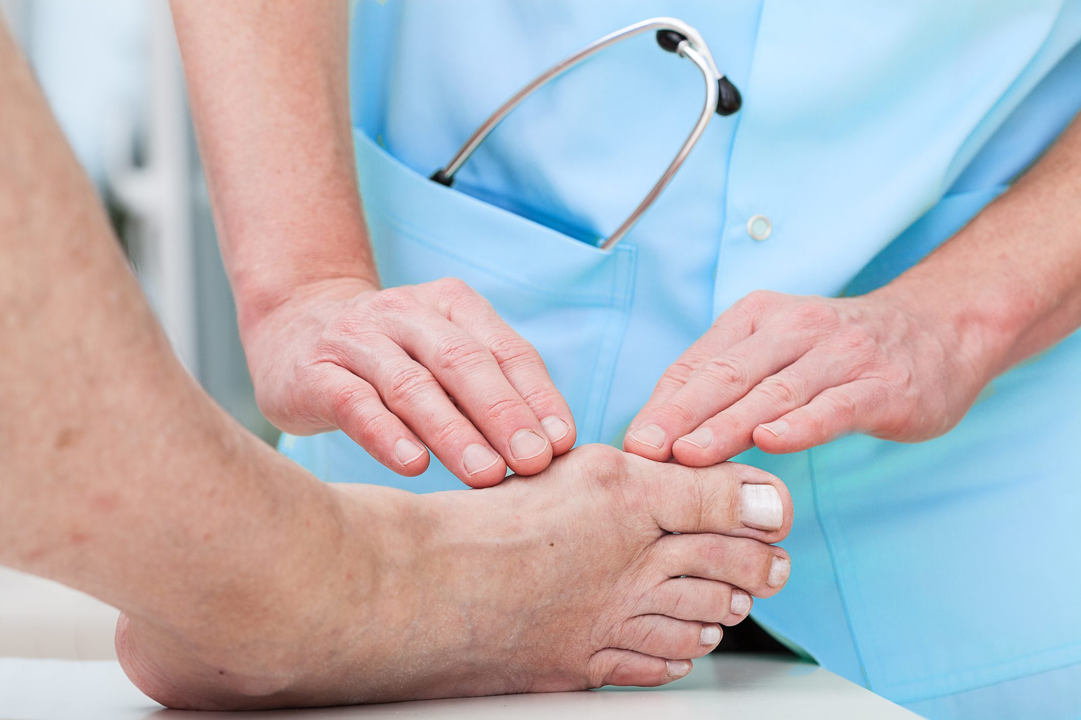 doctor examining patient's foot