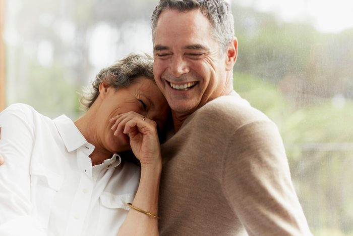 Cheerful mature couple at home
