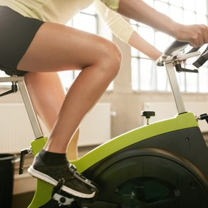Fitness woman working out on exercise bike