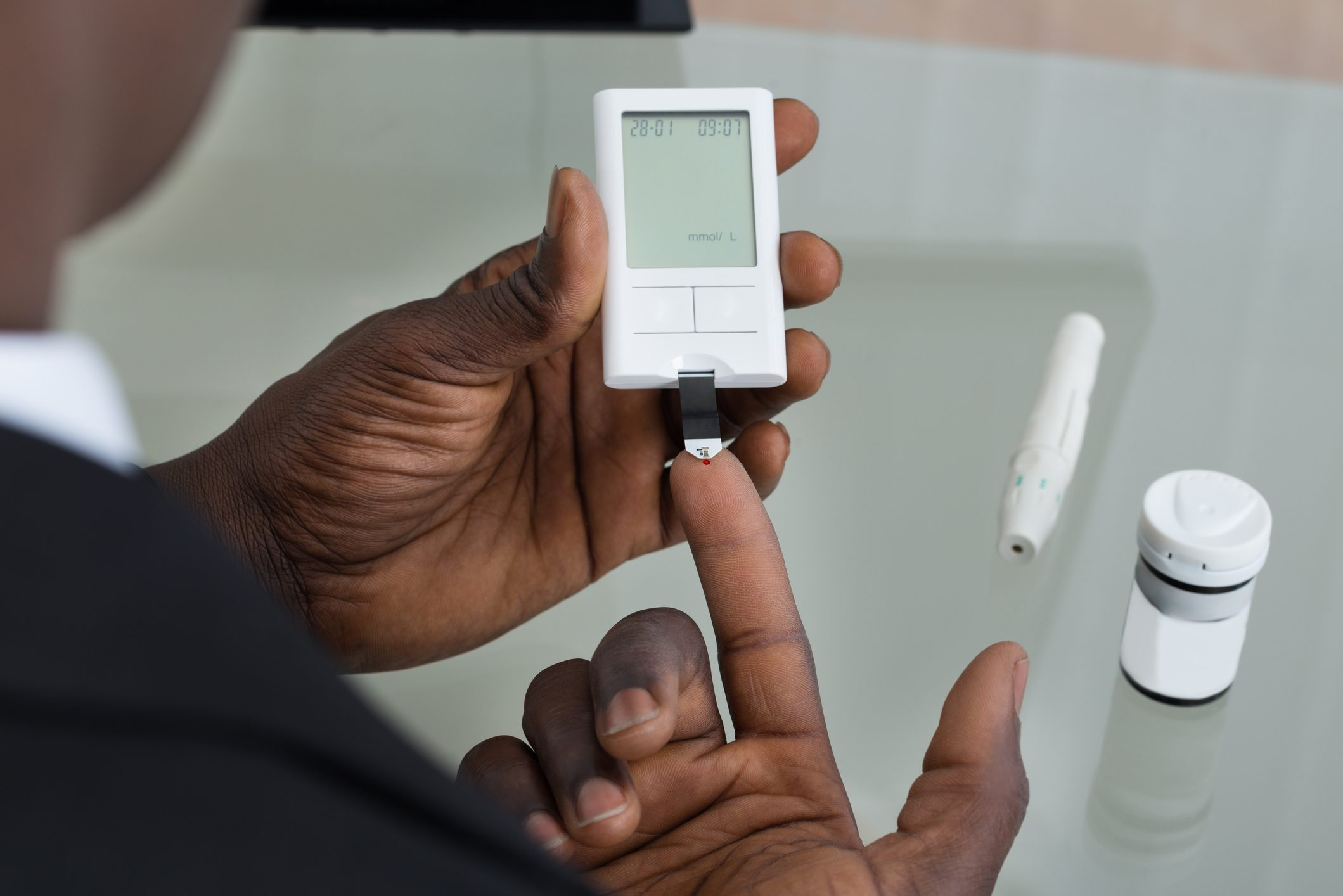 Patient Hands With Glucometer