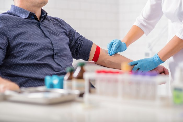 Professional doctor preparing patient for procedure