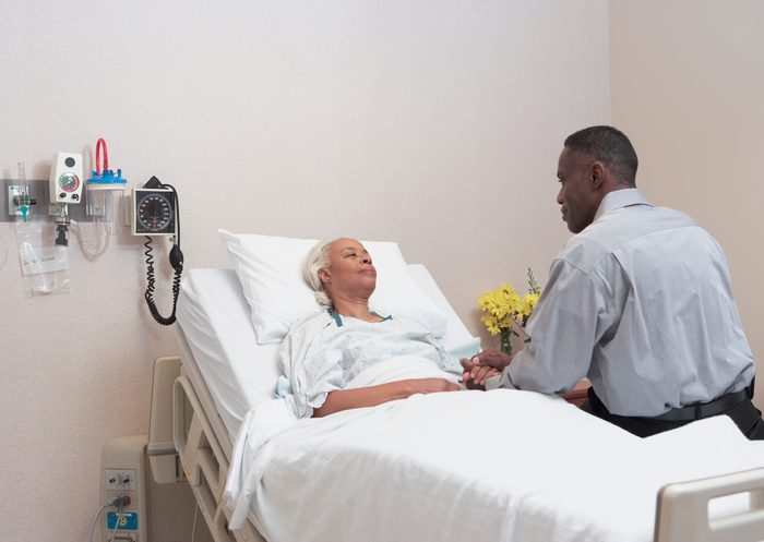 man visiting mother in hospital