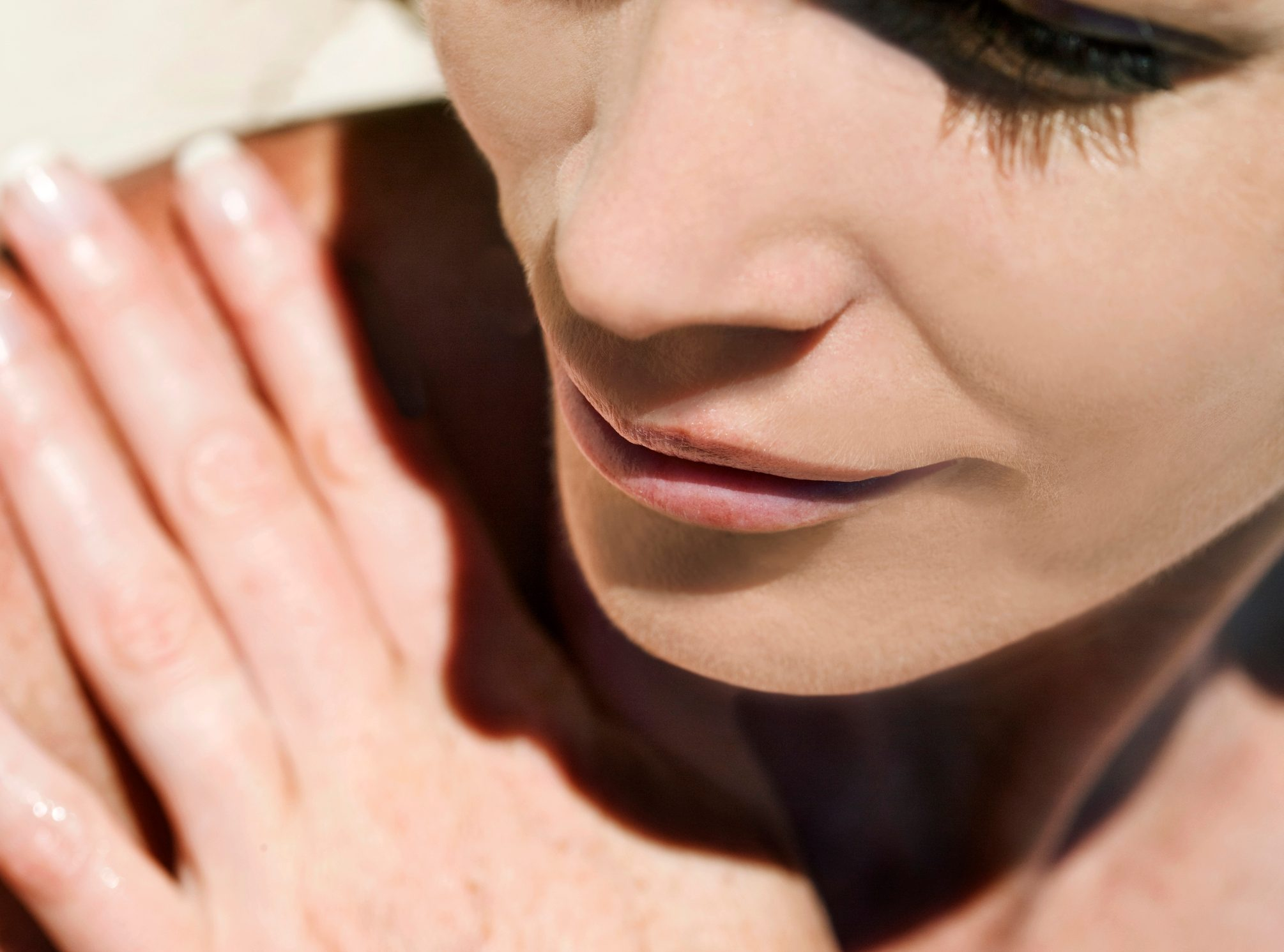 close up of young woman in the sunshine