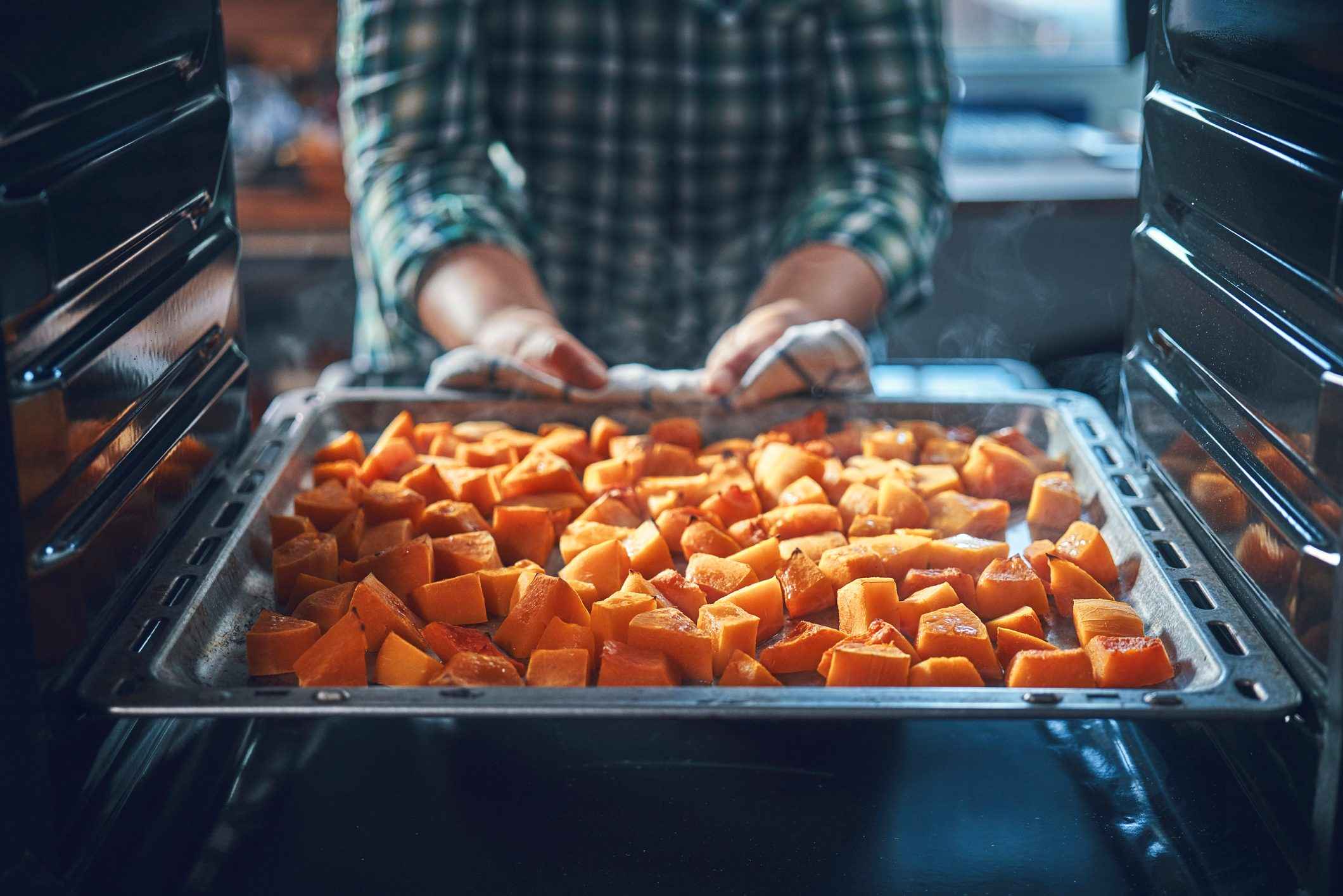 Cutting Fresh Pumpkins for Roasting in the Oven