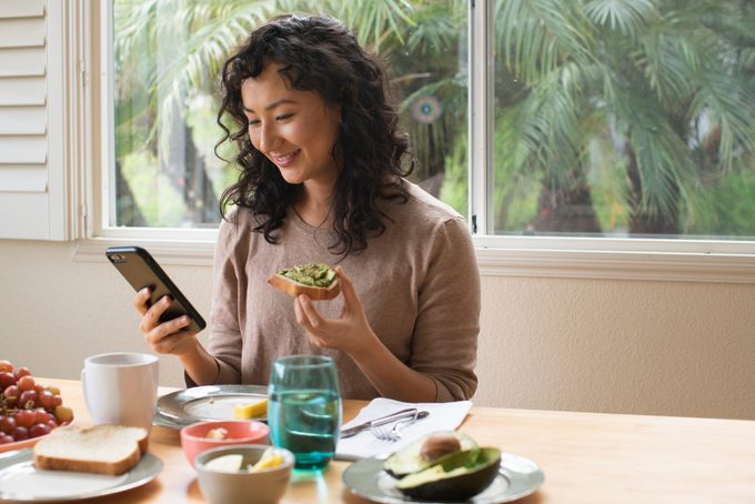 Young Asian woman eating a healthy breakfast