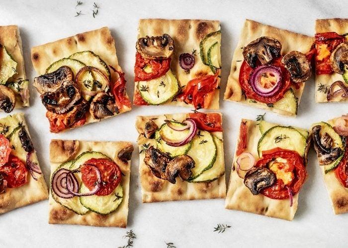 Vegetarian flatbread pizza on white background