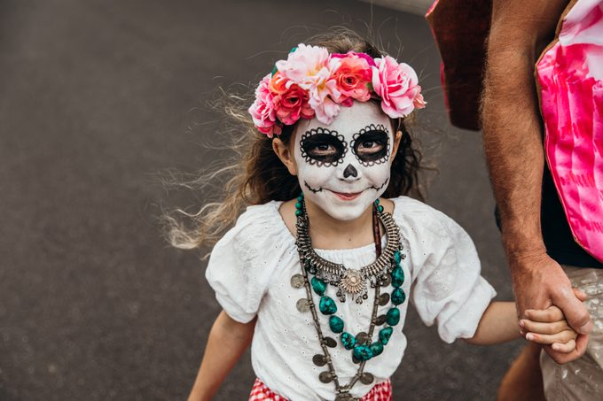 little girl dressed for Day of the Dead