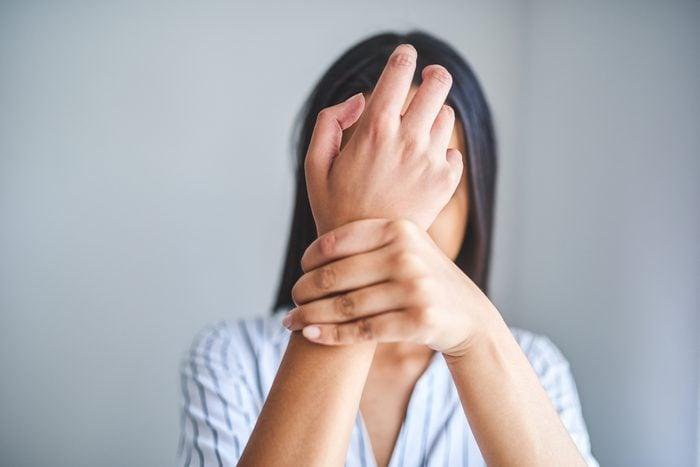 woman holding wrist