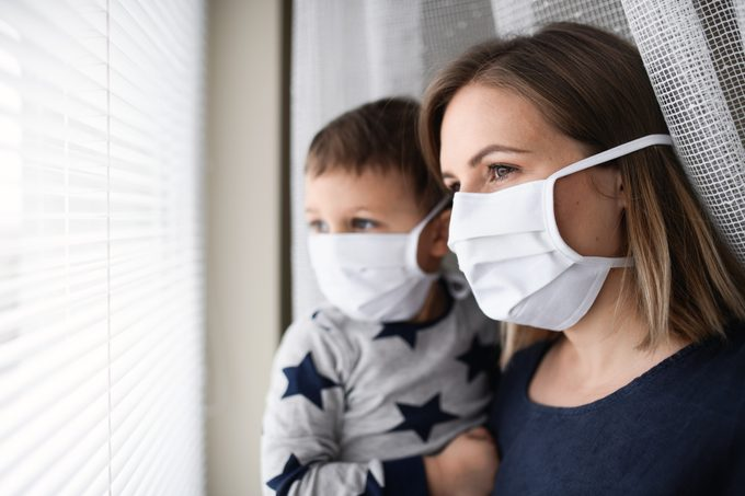 Mother and small son wearing face masks