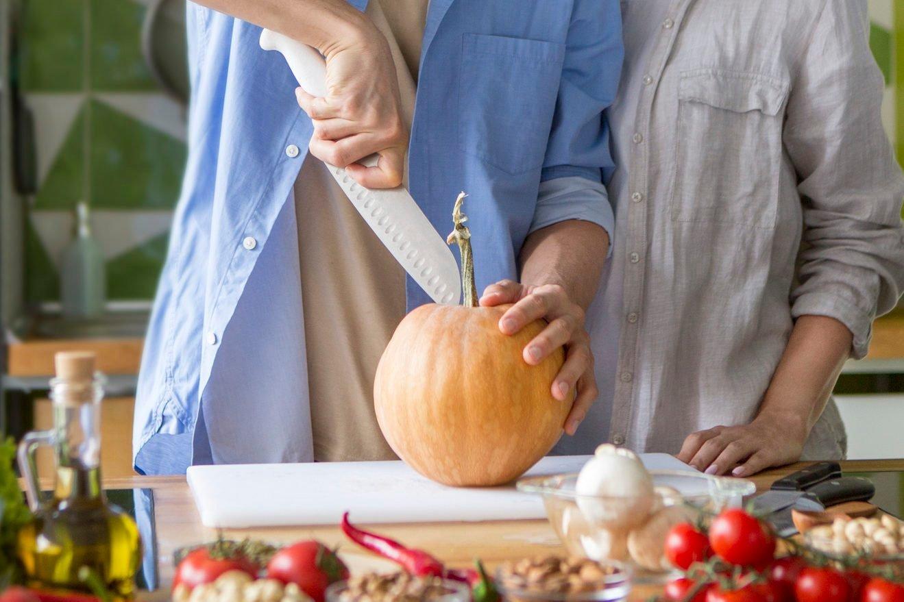 slicing small pumpkin