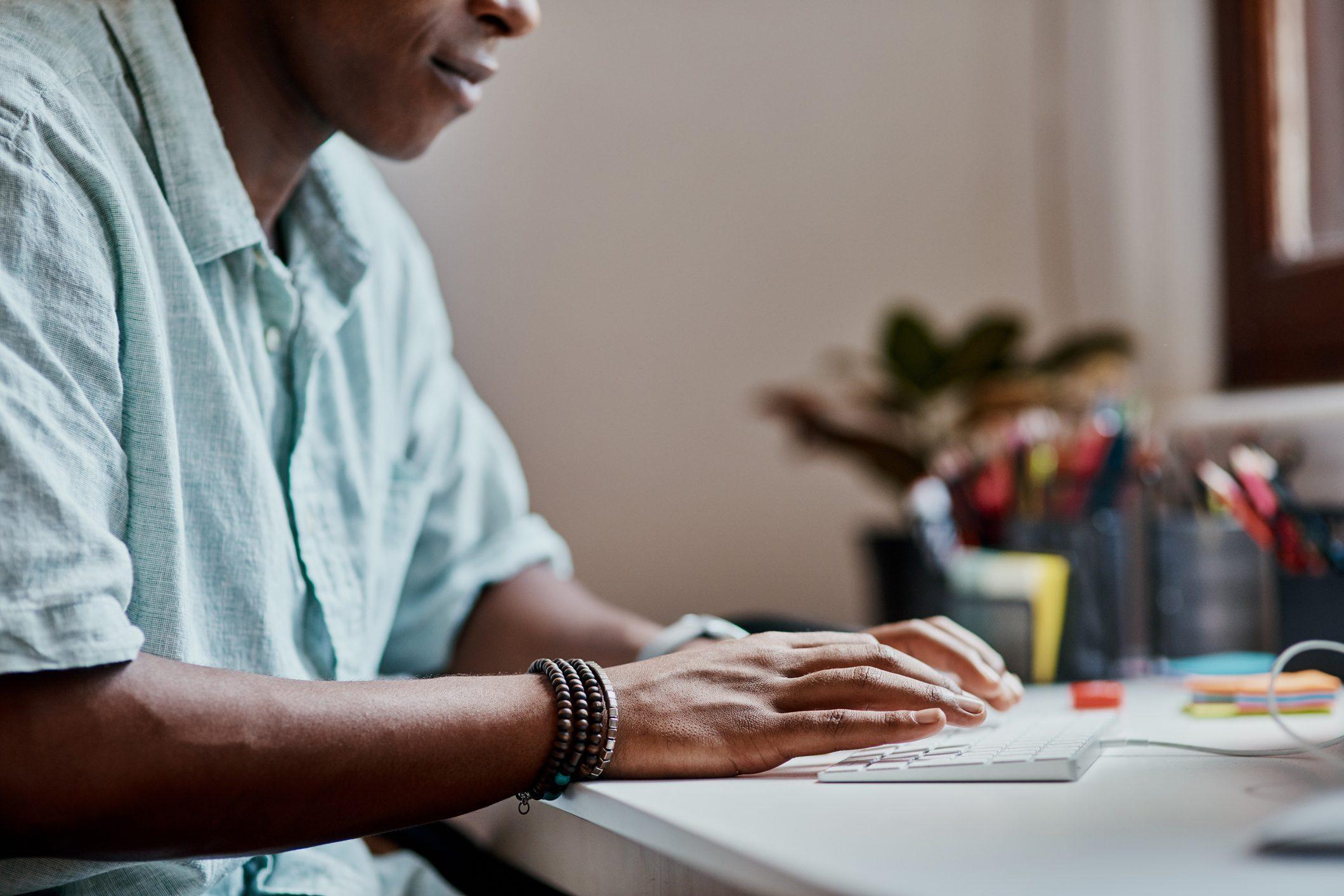 man working at keyboard