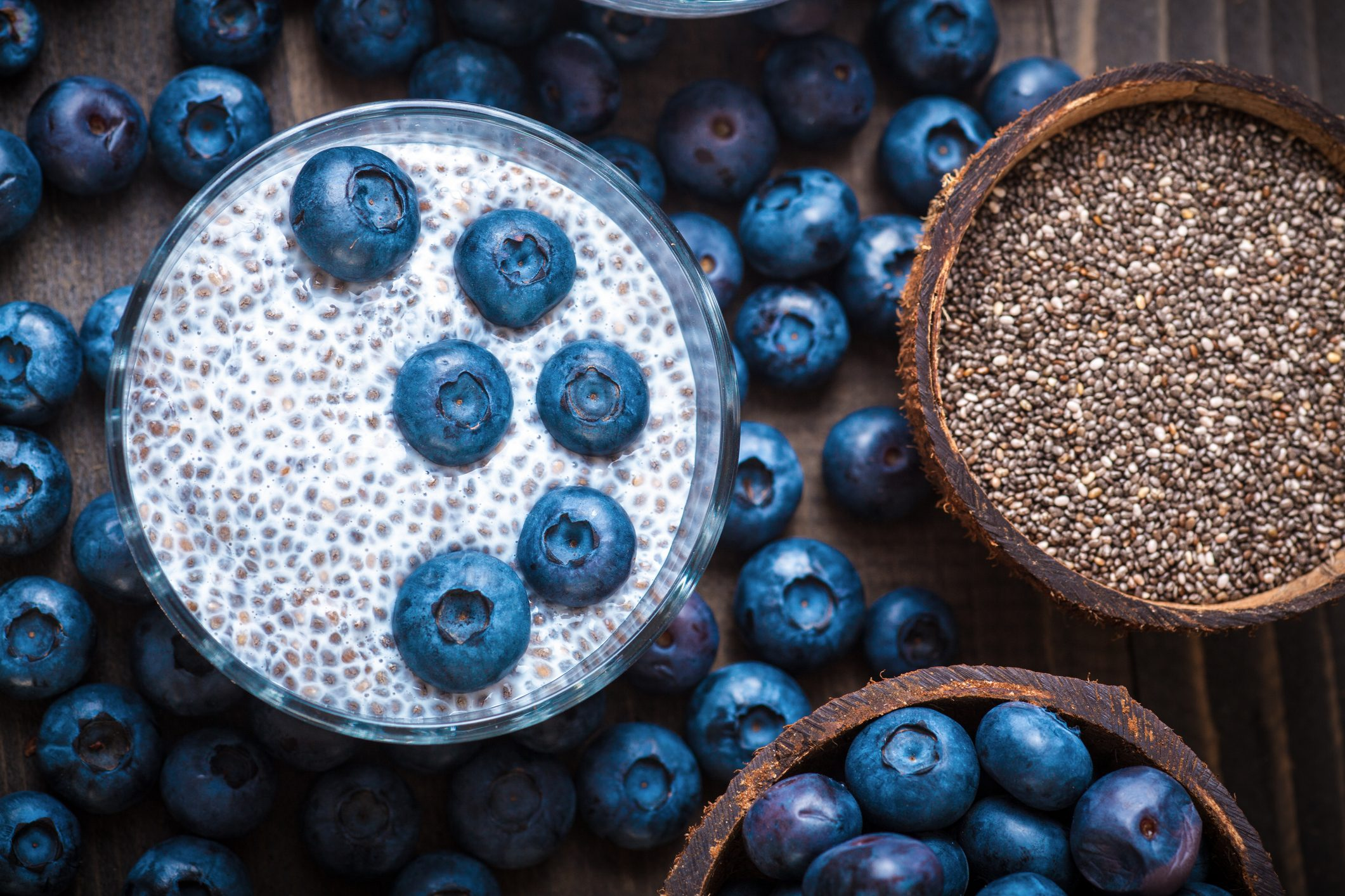 Chia Pudding, blackberry in coconut shell