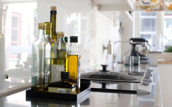 oil Bottles on kitchen worktop, close-up