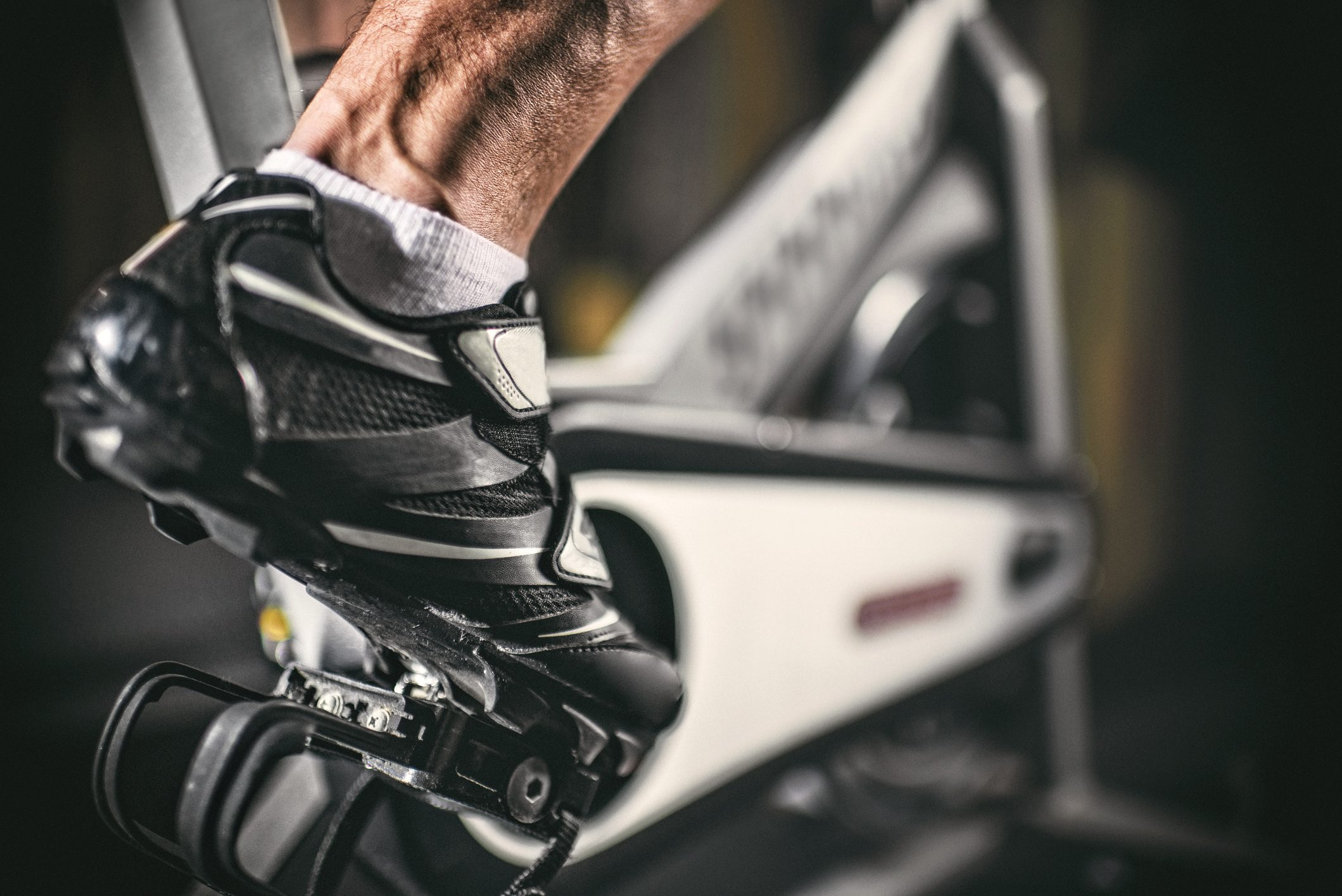 close up of man's foot on indoor cycling bike