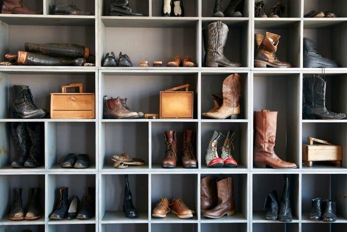 Display of boots and shoes on shelves in traditional shoe shop