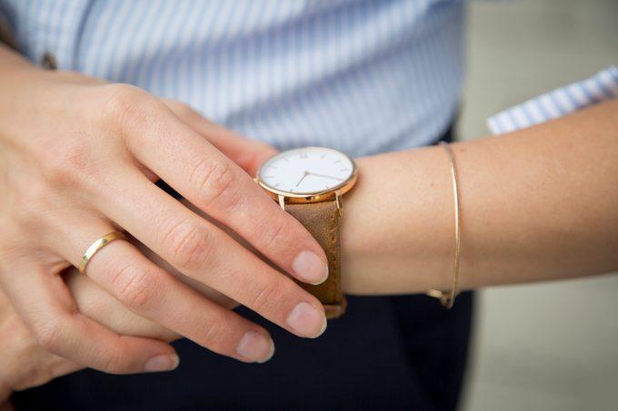 Businesswoman wearing wrist watch, close-up