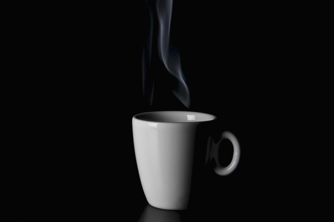 white coffee mug on black background