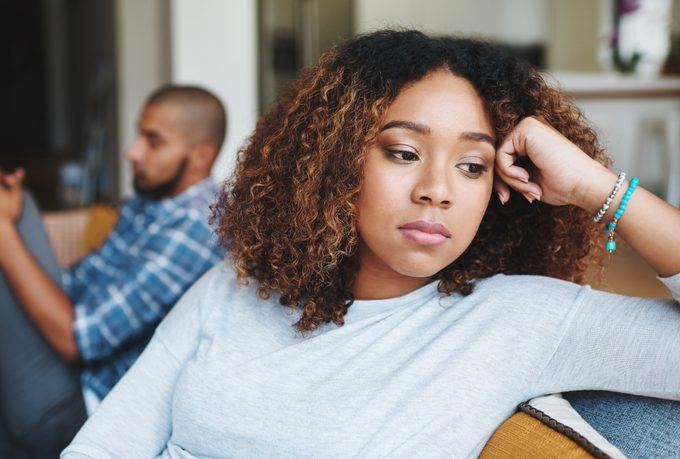 woman looking away from man, argument